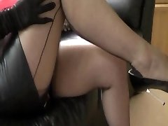 Breasty wife in leather and nylons teases cuck