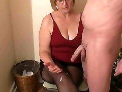 Mrs. Watson gives her neighbour a handjob