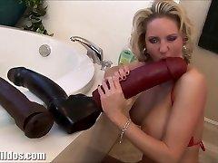 Busty milf dumping from a huge dildo
