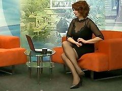 Lengthy legs in black pantyhose and heels on TV 0
