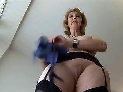 Mature English platinum-blonde babe in stockings upskirt tease