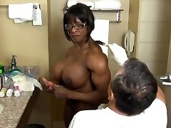 Extremely muscled ebony getting ready