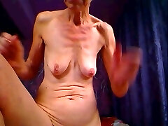 UGLY GRANNY POSES FOR Web Cam AND POKES ASS