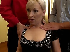 MILF poker player lets horny men squeeze her boobs