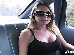 Big breasted blonde showing off her cocksucking abilities in the car