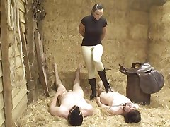 Mean mistress and her stable boy slaves