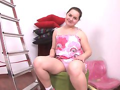 chubby brunette girl  masturbates her shaved pussy