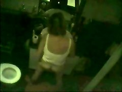 Covert cam caught milf fingering in front of mirror