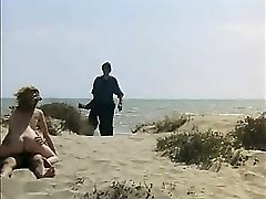 Spycam Guy milking and fuck redhead girl on a public beach