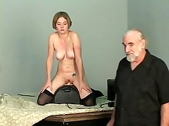 Brief-haired b-cup blonde lowers her pussy onto mechanical fuck stick