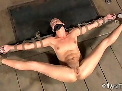 Slender brunette is restrained and tied up before pussy punishing
