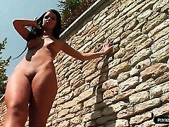 Exhibitionist sex doll enjoys fingering herself outdoor