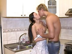 Tanned teen girl having her first anal sex on the kitchen table