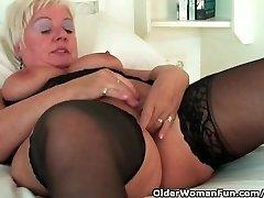 Chubby grandma with big melons wears black stockings and masturbates