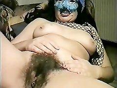 Masked Italian MILF pounds herself
