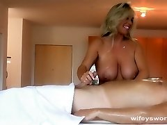 Buxom MILF Gives Oil Rubdown And Handjob