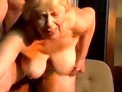 Ash-blonde chubby grannie.