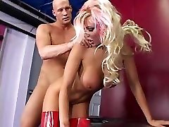 Whore in red latex fucks dude by a strap on dildo