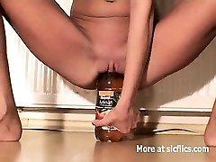 Skinny slut fucking massive bottles