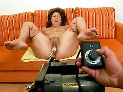 Fat cougar chick is exploring a new sex machine with her legs spread wide open