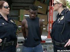 Caucasian police ladies fucks dark-hued scofflaw in 3 way