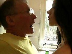 Daring young brunette fucks hard granddad in the kitchen