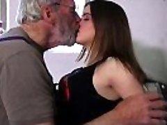 Bearded big lollipop grandpa pushing teeny in garage