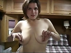 Wild dark haired with big tits plays with her pussy on her bed