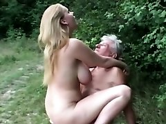 Natural massive titted wench fucks grandpa in the woods