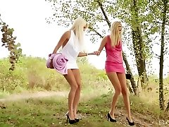 Two scorching young blonde girls outdoors make out and get into softcore lesbian activity