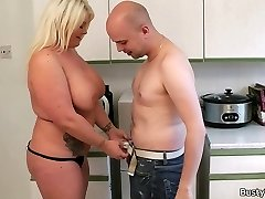 Enchanting blonde plumper rides boss cock