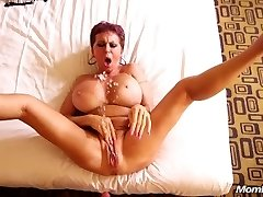 Busty European GILF squirts on a youthfull cock