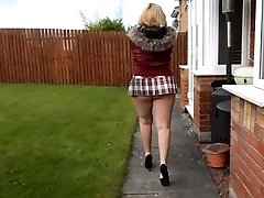 Mature neighbour walks with short skirt and bare ass outdoors