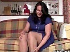 Curvy mamma in pantyhose fucks a dildo