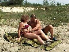 Mature with smallish tits hefty nipples gets fuck on beach