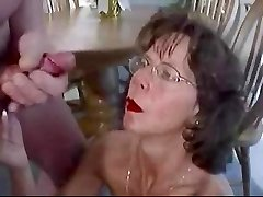Mature brunette in glasses cherishes hefty facial cumshot.