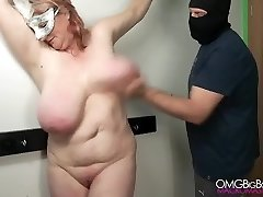 Slapping my slave's large tit until she comes