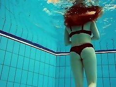 Beautiful Vesta stripping underwater in titillating solo video