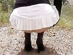 Housewife In Stockings And Stocking Flashing At Side Of A Active R