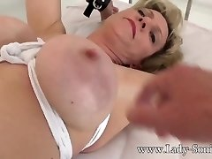 British mature Nymph Sonia gagged and bound to the couch