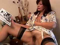 Busty hairy mature brunette stunner poses and unclothes