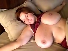 Homemade clip with my redhead wife flashing her tremendous boobs