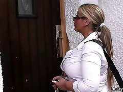 Working blonde plus-size in stockings stretches legs
