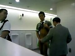 Man jacks of in public wc for audience