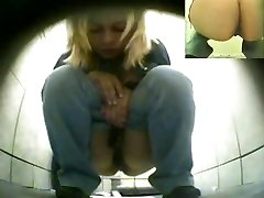 Unsuspecting blonde on hunkers pissing in a restroom