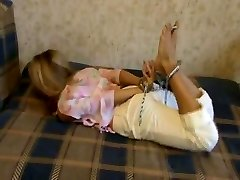 Shackled and hogtied gal