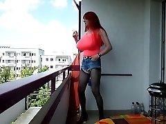 Redhead with Monster Bazookas smokingoutdoor