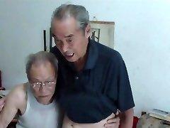 Chinese senior men comparing chisels