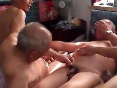 Four Japanese elderly in a bedroom