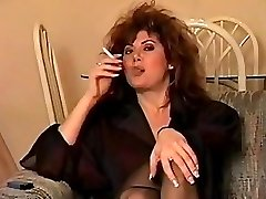 Old-school early 90's smoking with ample hair, perfect.